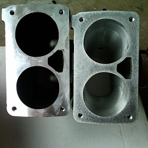 compare ported plenum to stock plenum. Note the aluminum thickness around edges and between intake openings.