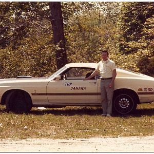 My father with his 1969 428 Cobra Jet Mach 1, circa 1972, a very frequent class winner and top eliminator in stock class at NY National Speedway in ea